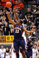 WEST LAFAYETTE, IN - JANUARY 02: Tracy Abrams #13 of the Illinois Fighting Illini and Rapheal Davis #35 of the Purdue Boilermakers battle for a rebound at Mackey Arena on January 2, 2013 in West Lafayette, Indiana. (Photo by Michael Hickey/Getty Images) *** Local Caption *** Tracy Abrams; Rapheal Davis