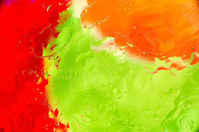 Colorful liquid fine art abstract, wet vibrant, and vivid studio micro shot.