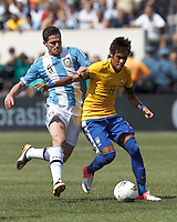 Brazil forward Neymar (11) dribbles as Argentina midfielder Fernando Gago (5) defends. In an international friendly (Clash of Titans), Argentina defeated Brazil, 4-3, at MetLife Stadium on June 9, 2012.