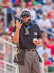 19 September 2015: MLB Umpire Ted Barrett motions for additional baseballs during a game between the Miami Marlins and the Washington Nationals at Nationals Park in Washington, DC. The Marlins fell to the Nationals 5-2 in the third game of their 4-game series. Mandatory Credit: Ed Wolfstein Photo *** RAW (NEF) Image File Available ***