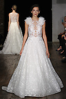 "Model walks runway in a ""L'Amour"" bridal gown from the Alyne by Rita Vinieris Fall 2017 collection on October 7th, 2016 during New York Bridal Fashion Week."