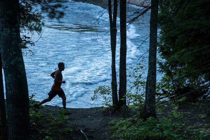 Trail running along Lake Superior in the Wetmore Landing area of Marquette, Michigan.