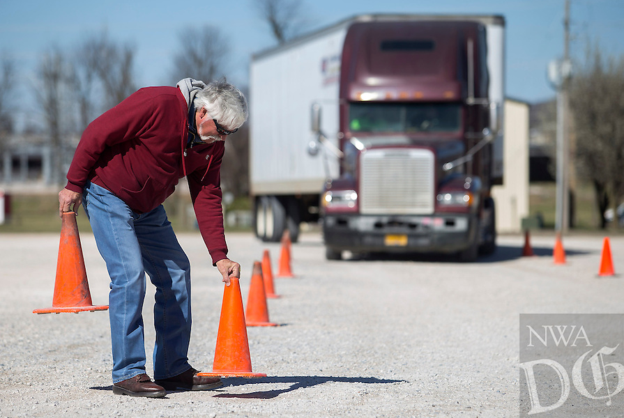 NWA Democrat-Gazette/JASON IVESTER<br /> Doug Carter, instructor, lines up pylons Wednesday, March 1, 2017, while a student drives at the CDL class at Northwest Technical Institute in Springdale.
