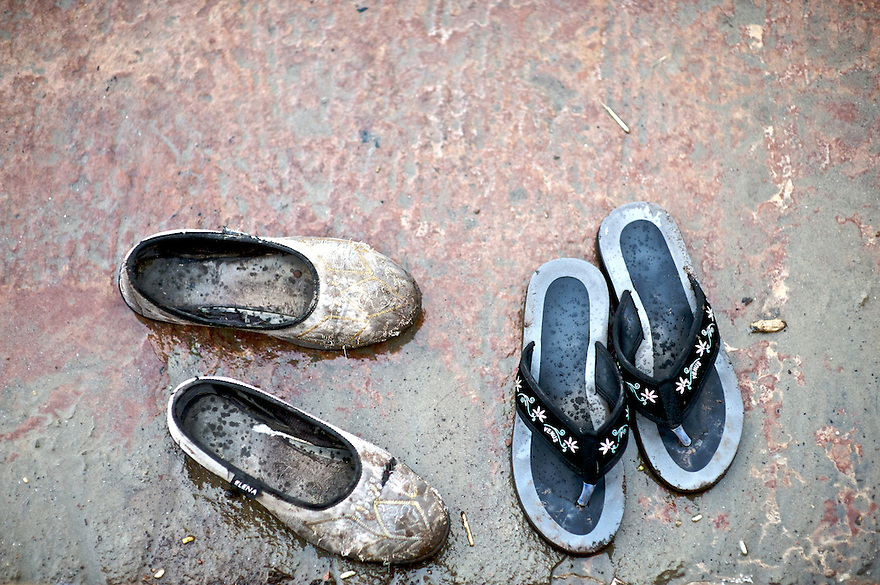 I was walking along the ghats of the Ganges River in Varanasi looking to make some images of the pilgrims when I looked down and was attracted to the two pairs of shoes and the story they might tell of who was in the water.