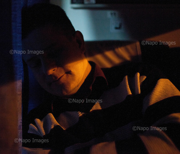 CENTRAL POLAND, FEBRUARY 2012:.Slawek at 5:30 in train to Warsaw. About 500 thousand people commute everyday from other towns and villages to work in the Polish capital..(Photo by Piotr Malecki / Napo Images)..Luty 2012:.Slawek o 5:30 w pociagu do Warszawy. Dojezdza ze Skierniewic. Okolo 500 tysiecy osob dojezdza codziennie z innych miast do pracy w Warszawie.  .Fot: Piotr Malecki / Napo Images