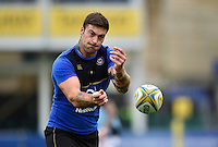 Matt Banahan of Bath Rugby passes the ball during the pre-match warm-up. West Country Challenge Cup match, between Bath Rugby and Exeter Chiefs on October 10, 2015 at the Recreation Ground in Bath, England. Photo by: Patrick Khachfe / Onside Images
