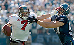 Tampa Bay Buccaneers quarterback Jeff Garcia (L)  tries to get away from  Seattle Seahawks Patrick Kerney in the second quarter of their season opener at Qwest Field in Seattle on September 9, 2007. (UPI Photo/Jim Bryant)