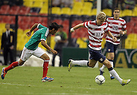 MEXICO CITY, MEXICO - AUGUST 15, 2012:  Brek Shea (11) of the USA MNT races away from Severo Meza (5) of  Mexico during an international friendly match at Azteca Stadium, in Mexico City, Mexico on August 15. USA won 1-0.