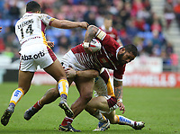 Wigan Warriors' Frank-Paul Nu'uausala is tackled by Huddersfield Giants' Ryan Hinchcliffe and Kruise Leeming (left)<br /> <br /> Photographer Stephen White/CameraSport<br /> <br /> Betfred Super League Round 5 - Wigan Warriors v Huddersfield Giants - Sunday 19th March 2017 - DW Stadium - Wigan<br /> <br /> World Copyright &copy; 2017 CameraSport. All rights reserved. 43 Linden Ave. Countesthorpe. Leicester. England. LE8 5PG - Tel: +44 (0) 116 277 4147 - admin@camerasport.com - www.camerasport.com