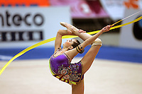 Anna Gurbanova competing for Azerbaijan pirouettes with ribbon during qualifications at 2006 Deriugina Cup Grand Prix in Kiev, Ukraine on March 17, 2006. (Photo by Tom Theobald)
