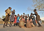 Children gather to sing and dance in the Southern Sudan village of Yondoru. Families here are rebuilding their lives after returning from refuge in Uganda in 2006 following the 2005 Comprehensive Peace Agreement between the north and south.
