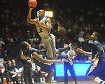 "Ole Miss guard Zach Graham (32) is fouled by Murray State forward Edward Daniel (2) at the C.M. ""Tad"" Smith Coliseum in Oxford, Miss. on Wednesday, November 17, 2010."