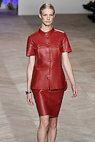 Alice walks the runway in a red leather short-sleeved button-down shirt, and red leather skirt, by Tommy Hilfiger for the Tommy Hilfiger Spring 2012 Pop Prep Collection, during Mercedes-Benz Fashion Week Spring 2012.