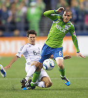 Vancouver Whitecaps FC  midfielder Shea Salinas tangles with Seattle Sounders FC \n\ Osvaldo Alonso  during play at Qwest Field in Seattle Saturday June 11, 2011. The game ended in a 2-2 draw.