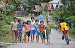 Novita Christiani Hia, 10, with the white shirt in the center, walks with friends in Tugala, a village on the Indonesian island of Nias. The fifth grader wants to be a doctor when she grows up.<br /> <br /> The village was struck by both a 2004 tsunami and a 2005 earthquake, leaving houses destroyed and lives disrupted. The ACT Alliance helped villagers here to construct new homes and latrines, build a potable water system, open a clinic and schools and get their lives going once again. For the residents of Tugala, the post-disaster mantra of &quot;build back better&quot; became a reality with help from the ACT Alliance.