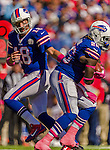 12 October 2014: Buffalo Bills quarterback Kyle Orton (18) hands off to running back Anthony Dixon (26) during a game against the New England Patriots at Ralph Wilson Stadium in Orchard Park, NY. The Patriots defeated the Bills 37-22 to move into first place in the AFC Eastern Division. Mandatory Credit: Ed Wolfstein Photo *** RAW (NEF) Image File Available ***