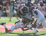 Ole Miss running back Brandon Bolden (34) rushes as Jacksonville State cornerback Jawaan Booker (2) and Jacksonville State defensive back Jason Horton (9) defendat Vaught-Hemingway Stadium in Oxford, Miss. on Saturday, September 4, 2010. Jacksonville State won 49-48 in double overtime.