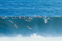 """Waimea Bay, Haleiwa, Oahu, Hawaii (Thursday January 20, 2011) Mark Mathews (AUS).  .George Downing (HAW) , Contest Director of The Quiksilver In Memory of Eddie Aikau,has called a """"NO GO"""" for competition at Waimea Bay today, based upon the inconsistency of the swell. While there were definitely 20- to 25-foot waves sporadically throughout the morning, the consistency of those large waves was deemed to be insufficient to run the two rounds of competition. The event still has until February 28 to run...""""What we see in conditions like this is just one or two true 'Eddie' size waves in the period of a heat,"""" said Downing. """"With seven surfers in the water per heat, that is not the kind of playing field we need for quality, fair competition...""""It's very easy to get caught up in the excitement when those huge waves come through, and after all of the efforts of the crew and the spectators to get ready for this day. But what keeps this event the greatest big wave event in the world is never relaxing those standards. Eddie never did...""""We will continue to wait. The holding period runs through February 28 and we know that there is definite potential in the coming weeks for more extra large surf to arise. If that day comes, we will be ready to go again...The 15,000-strong crowd that had gathered under moonlight since the very early hours of the morning understood the call and settled in for the day, regardless. With the world's best big wave riders making the most of the opportunity to put some time in at Waimea, they will be treated to spectacular rides throughout the day, without question...2002 Eddie winner and 10X world champion Kelly Slater was in firm agreement with the decision: """"It's a good call."""" said Slater. """"There are big waves out there, but there's not that many of them. It's not what we need..Photo: joliphotos.com"""