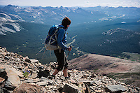 Female hiker descends rocky slopes of Mt. Dana (13,053 ft), Yosemite national park, California, USA