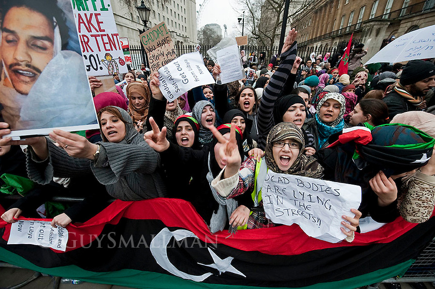 Mostly Libyan anti Gadaffi protesters demonstrate outside of Downing Street to demand action against Libyan ruler Colonel Gadaffi.