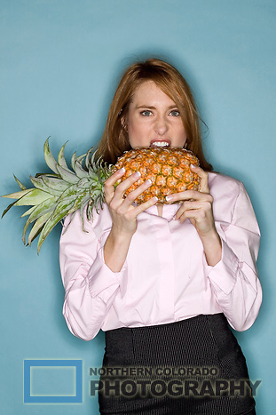 redhead eating pineapple