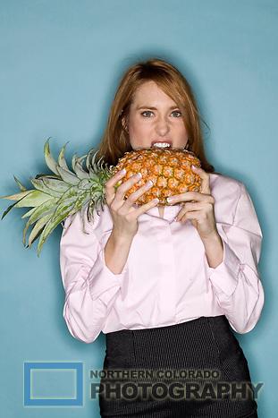 redhead eating pineapple