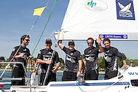 Black Match Racing from left to right - Adam Minoprio, Dave Swete, Tom Powrie, Dan McLean, and Nick Blackman after winning Match Race Germany 2010. World Match Racing Tour. Langenargen, Germany. 24 May 2010. Photo: Gareth Cooke/Subzero Images/WMRT