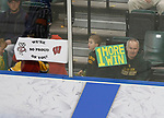 ST CHARLES, MO - MARCH 19:  Fans hold competing signs for the Wisconsin Badgers and the Clarkson Golden Knights during the Division I Women's Ice Hockey Championship held at The Family Arena on March 19, 2017 in St Charles, Missouri. Clarkson defeated Wisconsin 3-0 to win the national championship. (Photo by Mark Buckner/NCAA Photos via Getty Images)