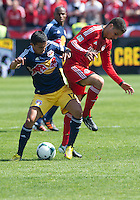 April 27, 2013: New York Red Bulls midfielder Tim Cahill #17 and Toronto FC midfielder Luis Silva #11in action during a game between Toronto FC and the New York Red Bulls at BMO Field  in Toronto, Ontario Canada..The New York Red Bulls won 2-1.