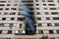 An apartment building on fire after police threw a gas canister through the window. Continued anti-government protests take place in Cairo calling for President Mubarak to stand down. After dissolving the government, Mubarak still refuses to step down from power.