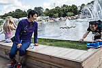 Two men joke around near the main fountain in Gorky Park on Saturday, August 17, 2013 in Moscow, Russia.