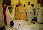 Black Christian church London Uk Church of God of Prophecy, the enthronement of a new Bishop. Members of the congregations prostrate themselves before him.