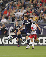 New England Revolution midfielder Marko Perovic (29) attempts to trap the ball as New York Red Bulls midfielder Seth Stammler (6) pressures. The New England Revolution defeated the New York Red Bulls, 3-2, at Gillette Stadium on May 29, 2010.