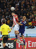 Paraguay defender Antolin Alcaraz wins a head ball over Japan's Keisuke HondaJapan and Paraguay played in the second round of the 2010 FIFA World Cup in Loftus Versfeld Stadium, in Pretoria, South Africa, June 29th. After regulation and extra time ended 0-0, Paraguay advanced to the quarterfinals, 5-3, in a penalty-kick shootout.