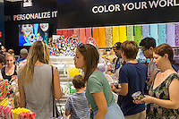 Customers shop at the grand opening of Dylan's Candy Bar in Union Square in New York on Tuesday, September 1, 2015. The new store, a downtown outpost of the Upper East Side flagship, is 3300 square feet in a high foot traffic location. Despite the candy, the average age of a Candy Bar customer is 30 years old.  (© Richard B. Levine)