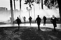 Chilean students run away from the tear gas attack lead by Chilean police during the anti-government protest in Valparaíso, Chile, 21 May 2002.