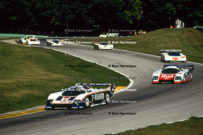 ELKHART LAKE, WI - AUGUST 24: The Team Zakspeed USA Ford Mustang Probe of Klaus Ludwig of Germany and Tom Gloy of the United States leads a group of cars during the Löwenbräu Classic IMSA GT race at the Road America track  near Elkhart Lake, Wisconsin, on August 24, 1986.