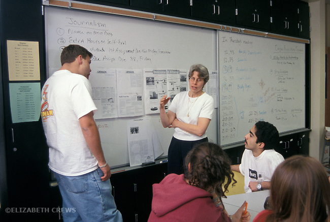 Albany CA Highschool journalism teacher reviewing schedule for getting out paper with student editors