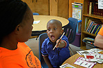 Carlos Kamuanya, a 3-year old asylum seeker from Angola, excitedly shows his mother a flash card during an English as a Second Language class at the Posada Providencia, a shelter in San Benito, Texas. Sponsored by the Catholic Sisters of Divine Providence, the shelter provides a safe place for people in crisis from all over the world who are seeking legal refuge in the United States.