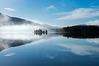 Clearing fog on lake Mjåvatnet, Nordland, Norway