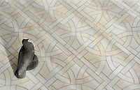Gran Via, a natural stone waterjet mosaic shown in Cloud Nine polished marble, is part of the Miraflores Collection by Paul Schatz for New Ravenna Mosaics.