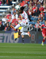 New York forward Peguy Luyindula (88) leaps high for a header.  The Chicago Fire defeated the New York Red Bulls 3-1 at Toyota Park in Bridgeview, IL on April 7, 2013.