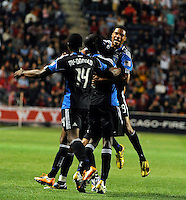 San Jose defender Ike Opara (6, middle) is hugged by teammates Brandon McDonald (14) and Ryan Johnson (19, right) after scoring the game winning goal during the second half of a match between the San Jose Earthquakes and the Chicago Fire at Toyota Park in Bridgeview, IL on April 10, 2010.  San Jose Earthquakes 2, Chicago Fire 1.