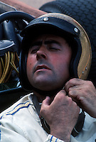 "Jack Brabham, 3 times Formula 1 world champion (1959, 1960 e 1966), preparing for start at Belgian Grand Prix at Spa Francorchamps in 1967. At 41 he was nicknamed ""the old man""."