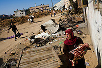 Attatra, Gaza Strip, Jan 21 2009.Fatma Al Attar, 39 with her last born, Mohanad, just 40 days old..Twenty-six members of the Al Attar family have to live in their burned down home, without windows, furniture, beds or clothes...