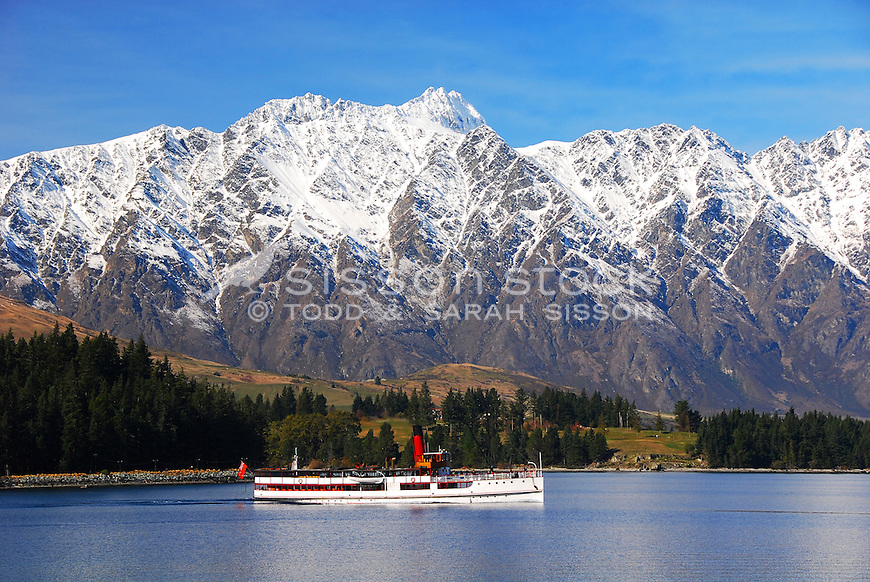 The Remarkables loom large over the Earnslaw steamer ship on Lake Wakatipu, Queenstown