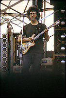Jerry Garcia of The Grateful Dead scoping out the Crowd during the First Set. In front of the Wall of Sound live at Dillon Stadium in Hartford CT on 31 July 1974