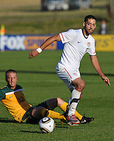 Clint Dempsey of USA and Vincenzo Grella of Australia...Football - International Friendly - USA v Australia - Ruimsig Stadium