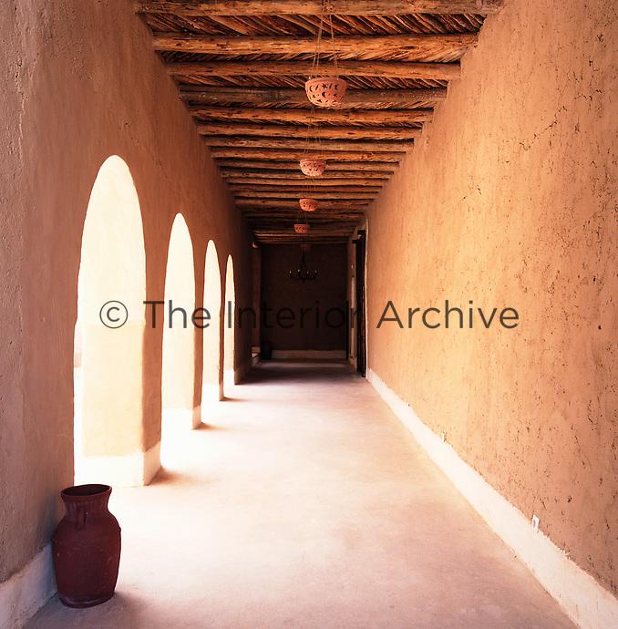 A view down a shady corridor