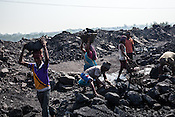 Day wage labourers load up coal on the trucks at the Bastacolla Colliery in Jharia, Jharkhand, India.